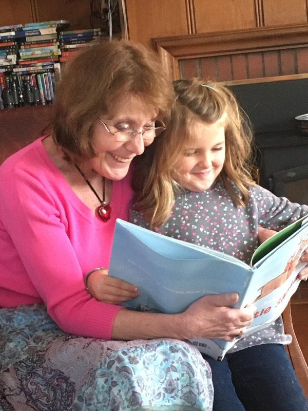 corilee-reading-to-her-granddaughter