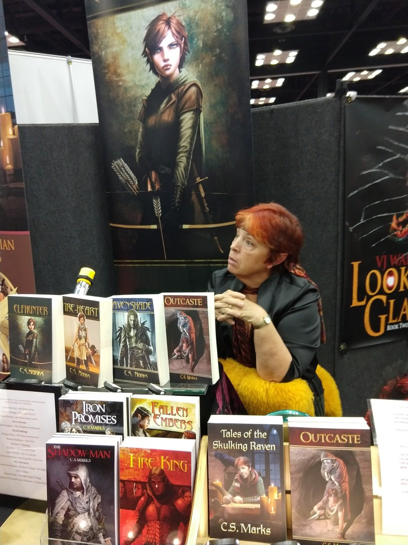 Author C.S. Marks discusses her books with prospective readers at Gen Con's Authors' Avenue